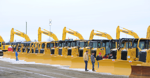 Dozers and excavators ready to sell at a Ritchie Bros. equipment auction in Canada