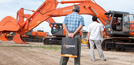 inspect the equipment at the auction site